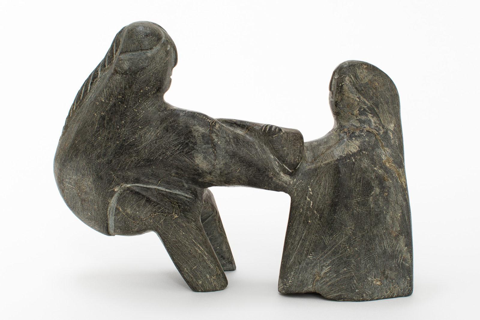 Elizabeth Nutaraluk Aulatjut  - untitled (man giving fish to woman)